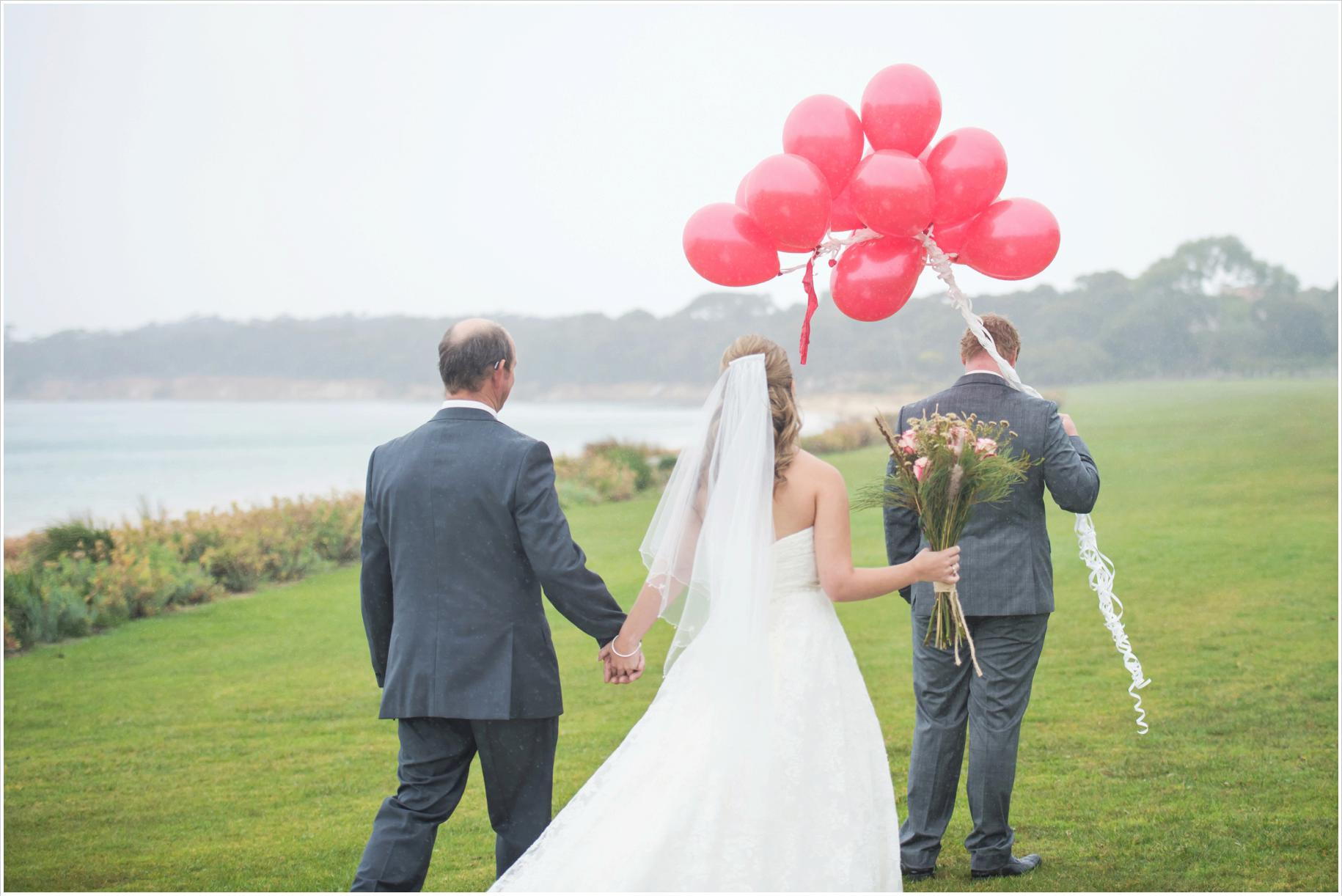 first look in the rain with red balloons