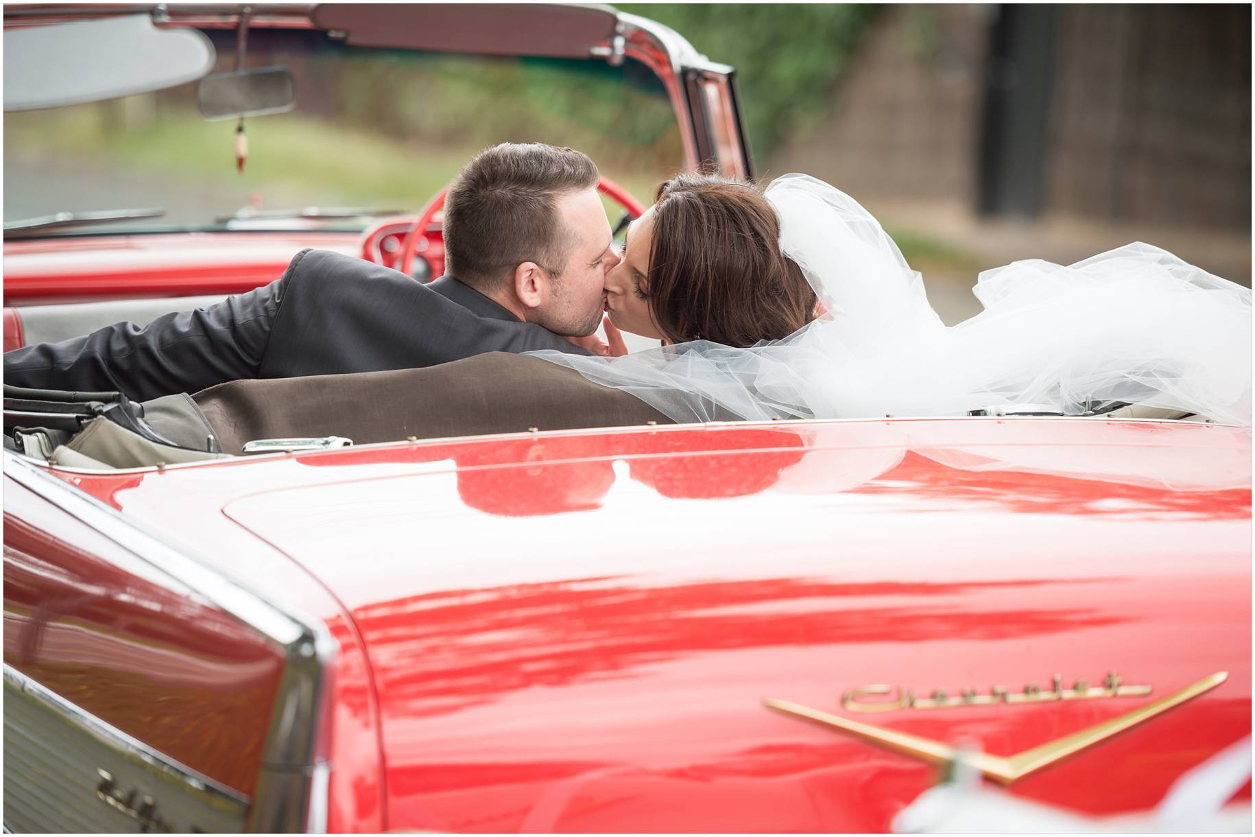 bride and groom and car